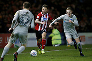 Neal Eardley of Lincoln City goes past Ronan Curtis of Portsmouth during the EFL Sky Bet League 1 match between Lincoln City and Portsmouth at Sincil Bank, Lincoln, United Kingdom on 28 January 2020.