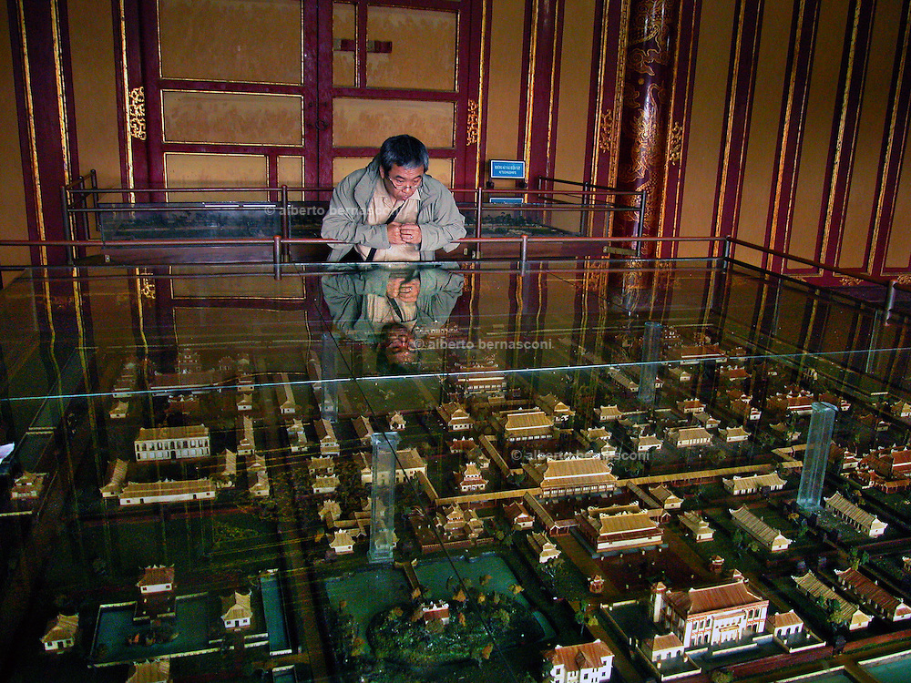 Vietnam, Hué: model of the ancient imperial town. ..Buildings in the central court of the Imperial City at Hué that were badly damaged during the Vietnam War are now topped with vegetation and surrounded by grassy fields...In 1968 the North Vietnamese army launched the Tet Offensive against U.S. troops who responded with heavy bombing that destroyed many buildings in Hué, the old imperial capital...