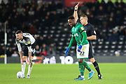 Sheffield Wednesday defender Moses Odubajo (22) is shown a yellow card by match referee Stephen Martin during the EFL Sky Bet Championship match between Derby County and Sheffield Wednesday at the Pride Park, Derby, England on 11 December 2019.