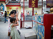 06 FEBRUARY 2014 - HAT YAI, SONGKHLA, THAILAND: A woman and her daughter offer New Year's prayers at the Tong Sia Siang Tueng shrine in Hat Yai. Hat Yai was originally settled by Chinese immigrants and still has a large ethnic Chinese population. Chinese holidays, especially Lunar New Year (Tet) and the Vegetarian Festival are important citywide holidays.     PHOTO BY JACK KURTZ