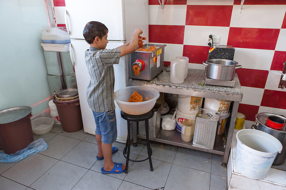 Young Syrian refugee working in the kitchen of a Syrian restaurant in Gaziantep, Turkey.