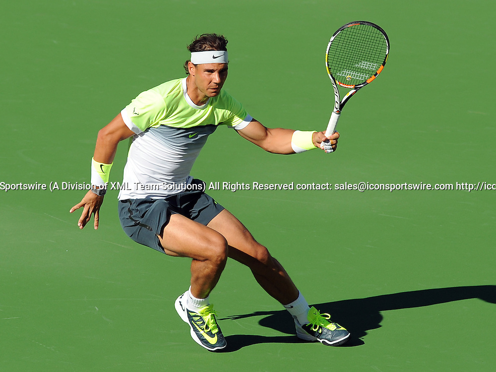 13 Mar. 2015: Rafael Nadal (ESP) in action while playing doubles with Pablo Carreno Busta (ESP) during a match against Pablo Cuevas (URU) and David Marrero (ESP) during the BNP Paribas Open Tennis Tournament played at the Indian Well Tennis Garden in Indian Wells, CA.