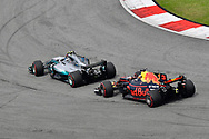 Max Verstappen of Red Bull Racing and Lewis Hamilton of Mercedes AMG Petronas battle during the Malaysian Formula One Grand Prix at the Sepang International Circuit, Malaysia.<br /> Picture by EXPA Pictures/Focus Images Ltd 07814482222<br /> 01/10/2017<br /> *** UK &amp; IRELAND ONLY ***<br /> <br /> EXPA-EIB-171001-0250.jpg