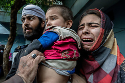 April 19, 2017 - Mosul, Nineveh Province, Iraq - Civilians are evacuated from a house in the Al Thawra neighborhood by Iraqi forces. The recapture of al-Thawra neighborhood is part of a push toward the western edge of Mosul's densely populated old city center.(Credit Image: © Gabriel Romero via ZUMA Wire)