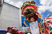 "05 JULY 2014 - BANGKOK, THAILAND:  Chinese style lion dancers perform on a side street in Bangkok during a parade for vassa. Vassa, called ""phansa"" in Thai, marks the beginning of the three months long Buddhist rains retreat when monks and novices stay in the temple for periods of intense meditation. Vassa officially starts July 11 but temples across Bangkok are holding events to mark the holiday all week.   PHOTO BY JACK KURTZ"