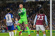 David Button (GK) (Brighton) saves the ball looked on by Gaetan Bong (Brighton) & Jota (Aston Villa) during the EFL Cup match between Brighton and Hove Albion and Aston Villa at the American Express Community Stadium, Brighton and Hove, England on 25 September 2019.