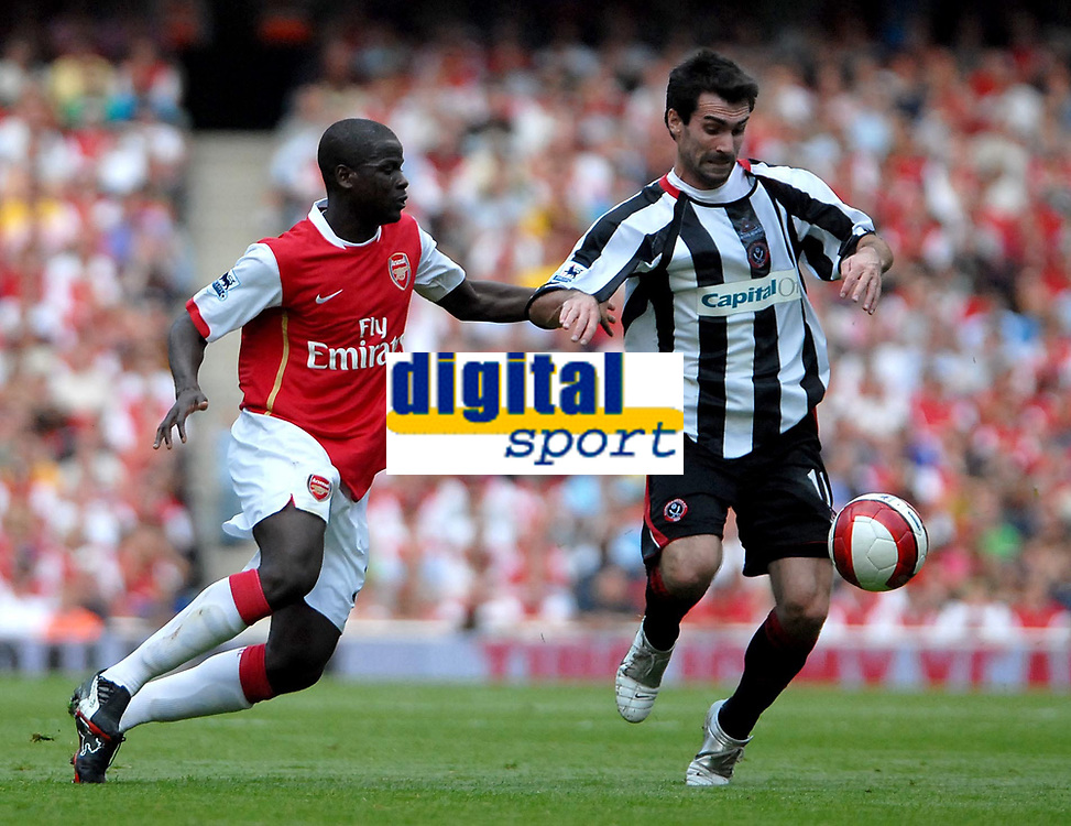 Photo: Ed Godden.<br /> Arsenal v Sheffield United. The Barclays Premiership. 23/09/2006. Arsenal's Emmanuel Eboue (L) chases Keith Gillespie.
