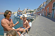 Fishing boats at the harbour of Ponza. Father and son.