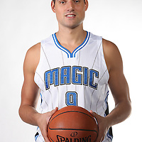 Orlando Magic center Nikola Vucevic poses for the camera during the NBA Orlando Magic media day event at the Amway Center on Monday, September 29, 2014 in Orlando, Florida. (AP Photo/Alex Menendez)
