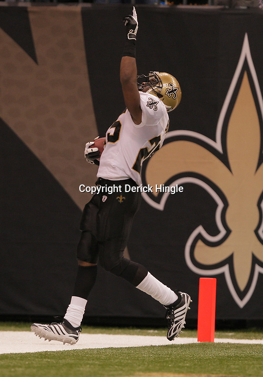 2008 October, 06: New Orleans Saints running back Reggie Bush (25) points to the sky after scoring on a 71-yard punt return in the third quarter of a week five regular season game between the Minnesota Vikings and the New Orleans Saints for Monday Night Football at the Louisiana Superdome in New Orleans, LA.