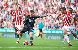 STOKE-ON-TRENT, ENGLAND - Sunday, August 9, 2015: Liverpool's Philippe Coutinho Correia in action against Stoke City during the Premier League match at the Britannia Stadium. (Pic by David Rawcliffe/Propaganda)
