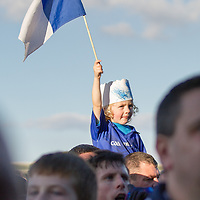 A young Oisin O'Doherty raises the Cratloe flag after his teams Football Final Win