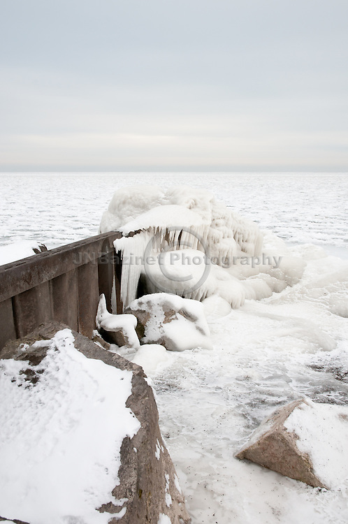 A breakwater on the shores of Lake Erie is covered in layers of ice.