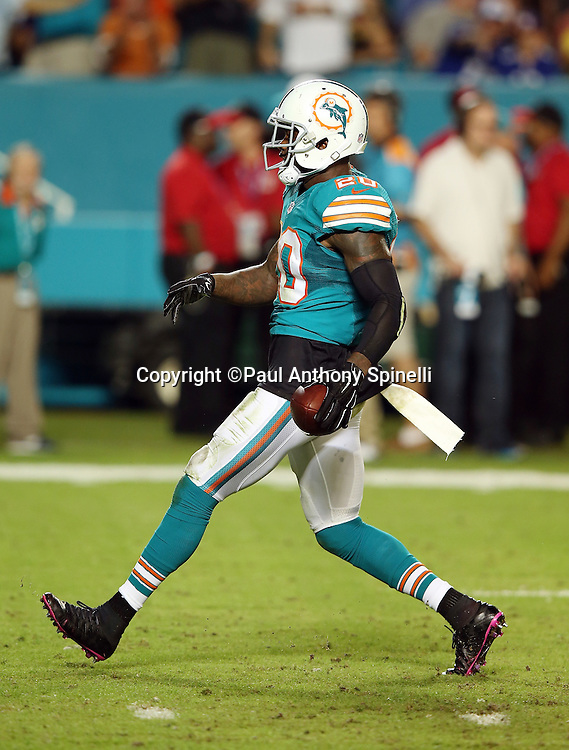 Miami Dolphins strong safety Reshad Jones (20) celebrates during the NFL week 14 regular season football game against the New York Giants on Monday, Dec. 14, 2015 in Miami Gardens, Fla. The Giants won the game 31-24. (©Paul Anthony Spinelli)