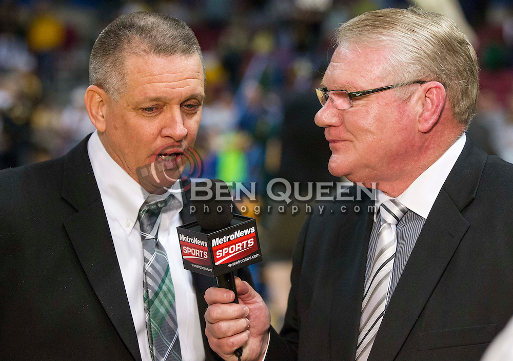 Huntington head coach Ronald Hess talks with MetroNews's Fred Persinger after winning the Class AAA championship game at the Charleston Civic Center.