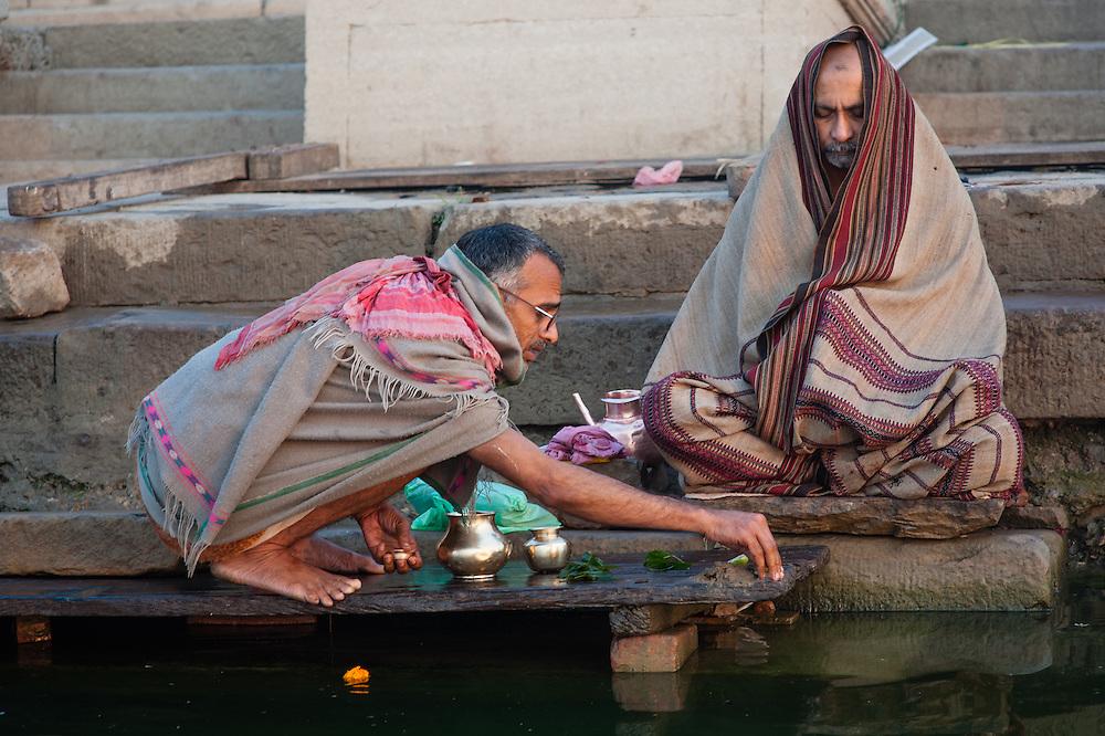 Man meditating by the Ganges river at Varanasi (India)