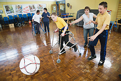 Children with physical and learning disabilities playing football,