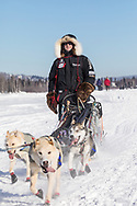 Musher Allen Moore competing in the 45rd Iditarod Trail Sled Dog Race on the Chena River after leaving the restart in Fairbanks in Interior Alaska.  Afternoon. Winter.