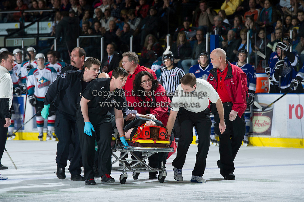 KELOWNA, CANADA - JANUARY 2:  Jeff Thorburn, athletic therapist of the Kelowna Rockets assists Khore Elliott, athletic therapist of the Victoria Royals and medical first responders as they tend to an injured Ben Walker #10 of the Victoria Royals after a collision with Royals' teammate #7 Tyler Stahl at the Kelowna Rockets on January 2, 2013 at Prospera Place in Kelowna, British Columbia, Canada (Photo by Marissa Baecker/Shoot the Breeze) *** Local Caption ***