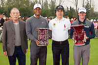 Tiger Woods of USA holds the runner up trophy and Rory McIlroy of Northern Ireland holds the winners trophy after the Duel at Jinsha Lake at the Golf Villa Jinsha Lake on October 29, 2012 in Zhengzhou, China. McIlroy beat Woods by a single stroke shooting a 67 to Wood's 68.  Photograph by David Paul Morris