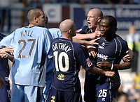 Photo. Glyn Thomas. <br /> Coventry City v Brighton and Hove Albion. <br /> Coca Cola Championship. 02/04/2005.<br /> Brighton's Mark McCammon (R) is pushed away after he aimed a punch at Coventry's Richard Duffy during a fracas which arose after Coventry's Michael Doyle sat on top of Brighton's Leon Knight in retaliation after Knight appeared to foul Coventry's Robert Page.