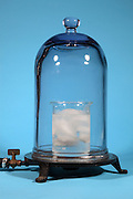 The vacuum chamber setup to boil ice water in a vacuum.  Ice water is placed in a beaker and the air is removed in a vacuum chamber.  Then the air pressure is lower that the waters vapor pressure the liquid will boil.