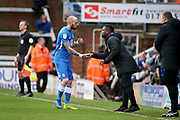 Peterborough Utd forward Marcus Maddison (21) celebrates his goal with Posh coach Aaron MaClean during the EFL Sky Bet League 1 match between Peterborough United and Wycombe Wanderers at London Road, Peterborough, England on 2 March 2019.