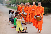 "Mar. 11, 2009 -- VIENTIANE, LAOS:  Buddhist Monks in Vientiane, Laos, go about their ""Tak Bat"" or monks morning rounds. The monks collect alms in the form of food from people who line their route. Photo by Jack Kurtz / ZUMA Press"