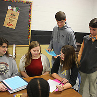 JOHN WARD/BUY AT PHOTOS.MONROECOUNTYJOURNAL.COM<br /> From left, Amory High School students Kaleigh Wren and Grace Reeves, school counselor Kemi Ford, Aubrey Gillentine and Cameron Keohn make preparations for National Honor Society recognition and graduation in May.