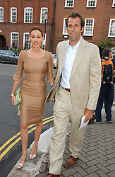 Tenns player GREG RUSEDSKI and his wife LUCY at Sir David & Lady Carina Frost's annual summer party held in Carlyle Square, Chelsea, London on 5th July 2006.<br />
