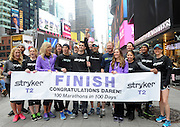 Stryker Orthopaedics employees pose with ultra marathon runner Daren Wendell, center in hat, as he celebrates the conclusion of his cross country journey, Friday, April 10, 2015, in New York's Times Square. Wendell ran 2,903 miles in100 consecutive days with a titanium rod called the Stryker T2 Tibia Nail in his right leg, which was surgically implanted following a severe soccer injury. (Photo by Diane Bondareff/Invsion for Stryker/AP Images)