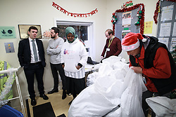 © Licensed to London News Pictures. 02/12/2016. Manchester, UK. Greater Manchester Mayoralty candidate ANDY BURNHAM MP visits the Barnabus homeless centre on Bloom Street in Manchester, as they distribute clothes . Barnabus provides food and support for people who sleep rough . In the last week , two people in Manchester and one in Birmingham have died whilst sleeping rough . Photo credit: Joel Goodman/LNP