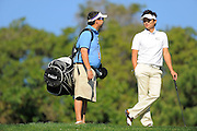 Ryuji Imada and his caddie during the pro-am prior to the Farmers Insurance Open tee markers on the North Course at Torrey Pines on Jan. 25, 2012 in San Diego, California...©2012 Scott A. Miller