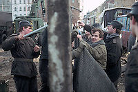January 1990, Berlin Wall, East Berlin, East Germany --- East German soldiers erect wire fencing to replace concrete sections of the Berlin Wall. East Berlin, East Germany. --- Image by © Owen Franken/CORBIS
