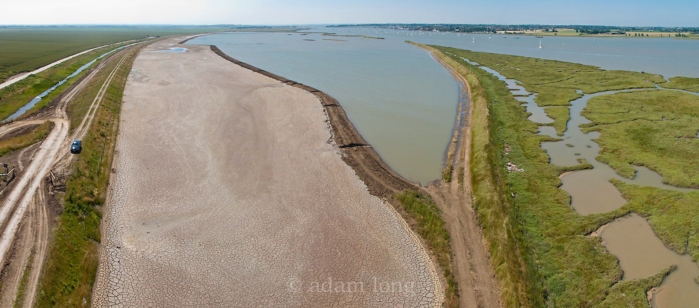 An aerial view of Wallasea Island, Essex, where seawalls have been breached to reduce storm surge pressure on the Thames Estuary, and returning farmland originally reclaimed from the sea to saltmarsh