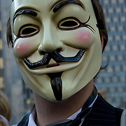 Masked Anonymous protester in business suit.  Grassroots, nonviolent efforts of the  Occupy Wall Street movement, the 99% protesters in Foley Square in lower Manhattan before they march to  Zuccotti Park. <br /> <br /> This movements is about income equality and social justice issues.