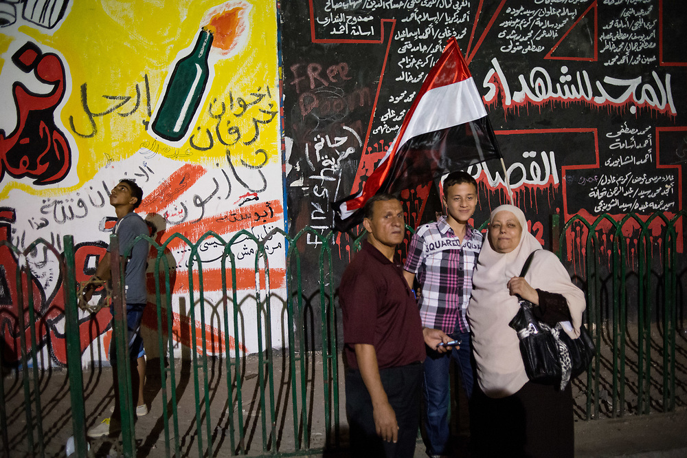 A family pose for a photo in a street next to Tahrir Square in Cairo, Egypt, July 5, 2013