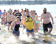 A group of plungers exit the 32 degree Delaware River during the eighth annual Eastern Polar Bear Plunge to benefit Special Olympics Pennsylvania (SOPA) Saturday January 30, 2016 at Neshaminy State Park in Bensalem, Pennsylvania. (Photo by William Thomas Cain)