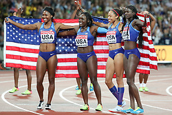 London, August 12 2017 . Team USA celebrate their victory in the women's 4x100m relay on day nine of the IAAF London 2017 world Championships at the London Stadium. © Paul Davey.