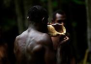 Vanuatu, Malampa Province, Malekula Island, big nambas blowing in a shell