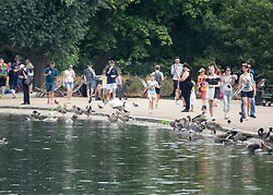© Licensed to London News Pictures. 27/07/2018. London, UK. Visitors to Hyde Park walk next to the Serpentine. Rain is expected later to break the heatwave in parts of the south. Photo credit: Peter Macdiarmid/LNP