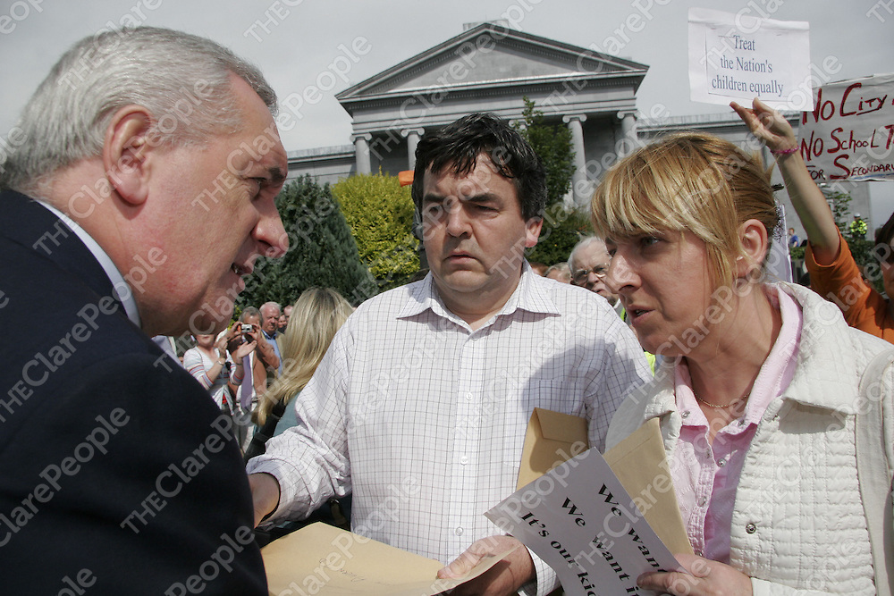 Taoiseach Bertie Ahern accepts petitions from the parents of Pallackenry, Co. Limerick who came to the People's Park in Ennis on Saturday to show their anger over the school bus situation in their area.<br /> <br /> Photograph by Yvonne Vaughan.