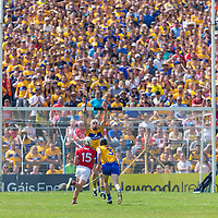 Clare''s Conor Cleary tries to block the route of Cork's Patrick Horgan