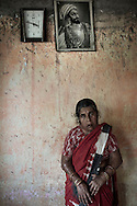 India, Maharashtra. Chandra, 42yo, was married to an alcoholic who kept asking money until one day he burned her throwing an oil lamp on her.<br /> The burns covered 80% of her body. Her family didn't help her and after having recovered she decided to stay on her own. Today  she works as a house cleaner and is economically independent, although she has a monthly salary of just 40 US dollars.<br /> Alessio Romenzi