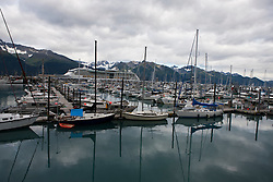 Sailboats in a marina with mountains in the background, Seward, Alaska, United States of America