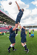 Terry Hollands (Englands strongest man) practices lifting Simon Shaw in the lineout - Training starts for inaugural RUGBY AID 2015 charity match which takes place on Friday 4th September 2015 at the Twickenham Stoop. The celebrity charity game will be in aid of RUGBY FOR HEROES  of which Mike Tindall MBE is Patron. The charity raises funds and awareness through the sport of rugby, the fan community and the wider professional player network, to support military personnel who are making the transition back from military service to civilian life. The teams (England v's Rest of the World) include former international rugby players, celebrities and serving members of the armed forces. Harlequins Rugby , The Stoop, Twickenham, London UK, 02 Sept 2015