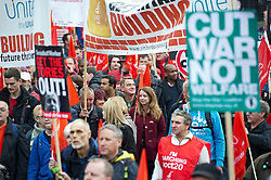 © London News Pictures. 20/10/2012. London, UK. Thousands of Union members and supporters take part in a mass rally organised by the TUC (Trades Union Congress) in central London on October 20, 2012 to protest against the government's austerity policies and call for an alternative economic strategy. The march is followed by a rally in Hyde Park in which Labour Party Leader Ed Miliband will speak. Photo credit : Ben Cawthra /LNP
