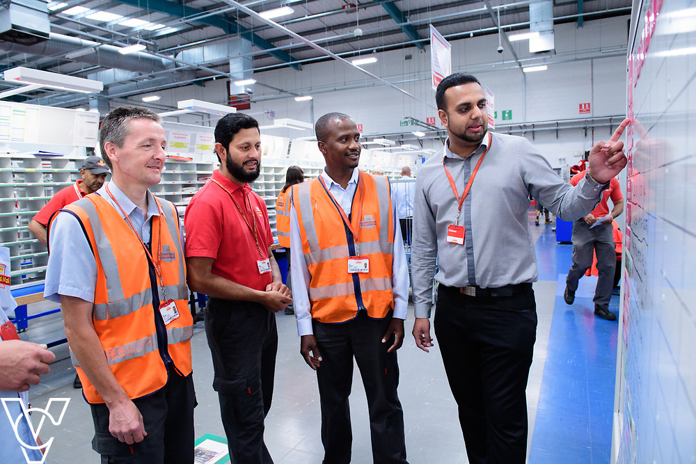 Two delivery offices, Oadby and Leicester South, which are both based inside the Leicester Mail Processing Unit building, have passed the penultimate gateway of One Plan.  One Plan is a business programme designed to have a standardised operation of excellence.  Pictured is Shahbaaz Khan, right, working with, from left, Ian Rosewarne, Shuaib Chowdhury and Collis Shepherd.<br /> <br /> Picture: Chris Vaughan Photography<br /> Date: July 7, 2017