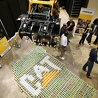 Adam Robison | BUY AT PHOTOS.DJOURNAL.COM<br /> Caterpillar employees gather around their food sculpture they built in the shape of the state of Mississippi, as the voting process started for best sculpture during the 2015 United Way Campaign Celebration Thursday at the BancorpSouth Arena in Tupelo.