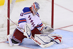 Jan 31; Newark, NJ, USA; New York Rangers goalie Martin Biron (43) makes a save during the third period at the Prudential Center.  The Devils defeated the Rangers 4-3 in an OT shootout.